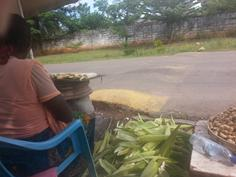 Esther sells roasted corn near UNZA in Lusaka, Zambia